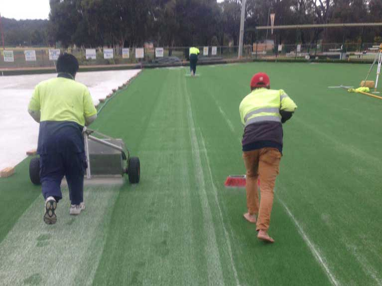 finishing synthetic grass on bowling green