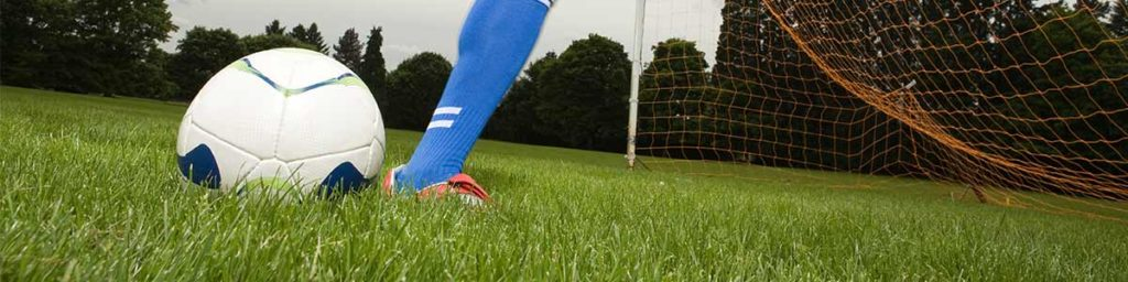 Soccer Field Close Up Leg and Ball