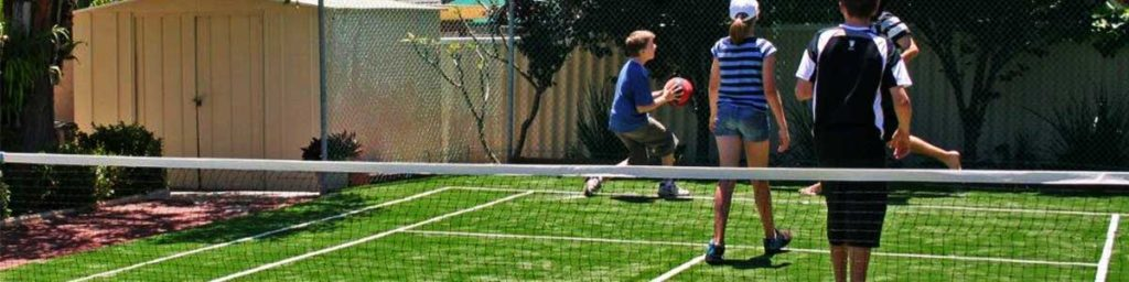 Synthetic Tennis Court in Backyard with Kids Playing